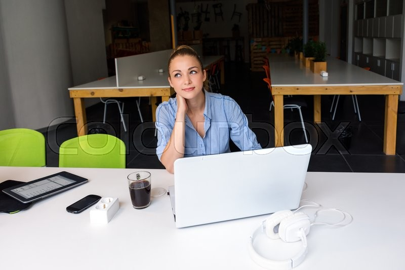 Business, technology and green office concept - young successful businesswoman with laptop computer at office. Beautiful woman using tablet computer, stock photo