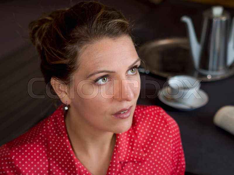 Stock foto af 'woman, teapot, quizzically'