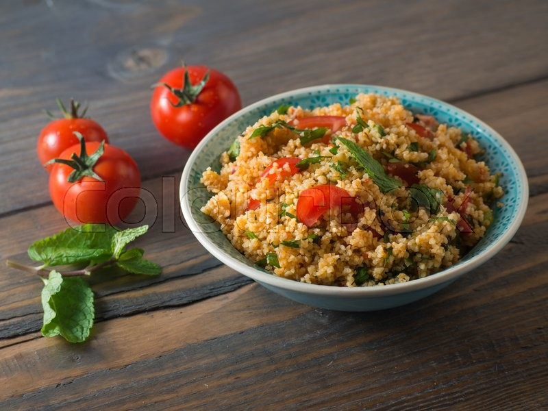 Stock Bild von 'Arabic traditional cuisine - Couscous with tomato and basil'