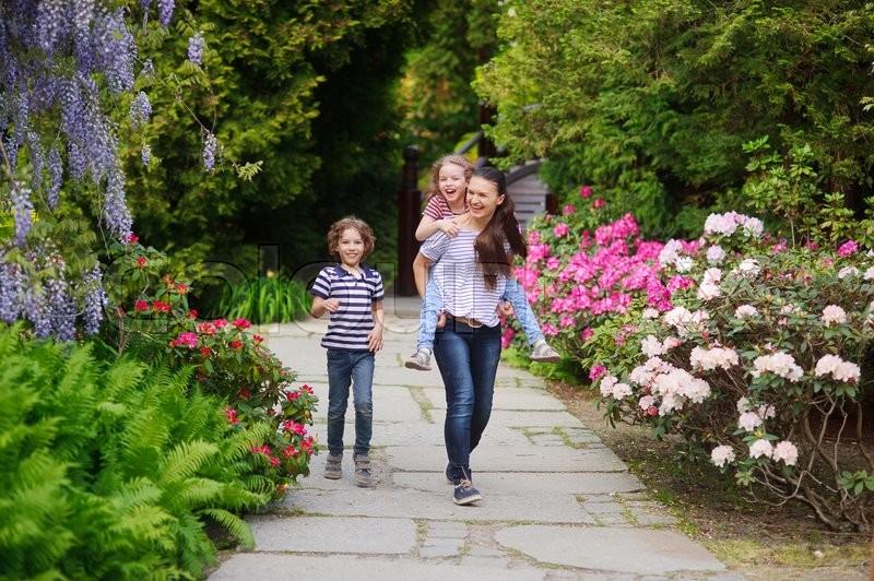 Walk In Garden Box: Family Walking Garden Paths. Girl Tired ...
