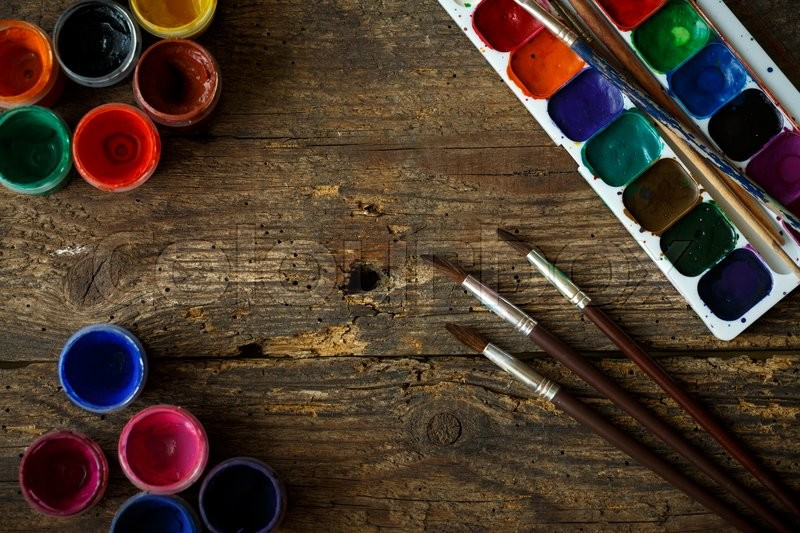 Art of Painting. Painting set: brushes, paints, watercolor, acrylic paint on a wooden background top down view, stock photo