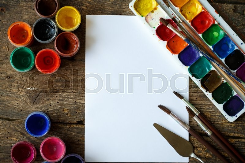 Art of Painting. Painting set: paper, brushes, paints, watercolor, acrylic paint on a wooden background top down view, stock photo
