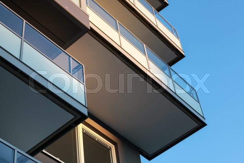 Abstract fragment of contemporary architecture, balconies with glass railings, stock photo