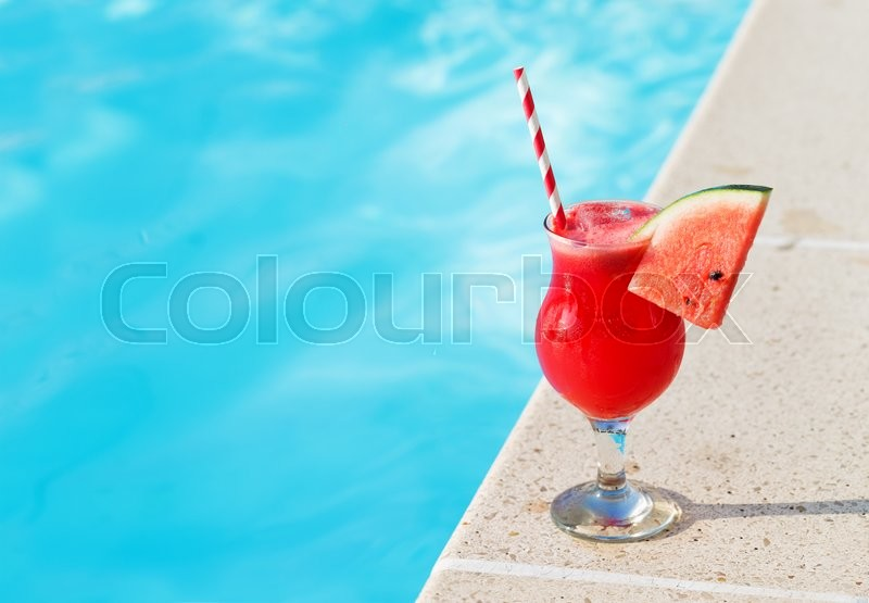 Water melon red fresh juice smoothie drink cocktail near swimming pool, stock photo