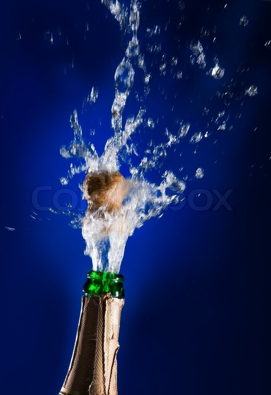 Close Up Of Champagne Cork Popping On Stock Photo