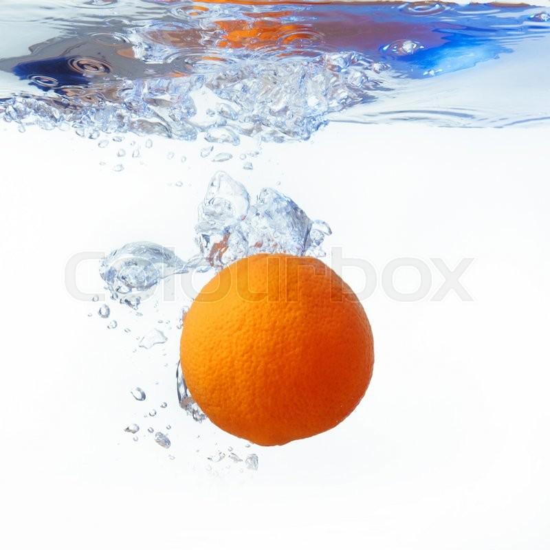 Orange in spray of water. Orange with splash on white background, stock photo