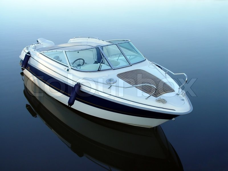 Small motor boat on quiet water | Stock Photo | Colourbox