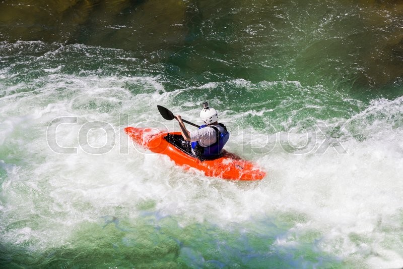 Kayaking in white water, blurred motion, stock photo