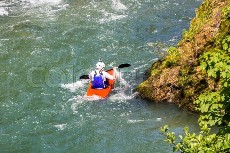 Kayaking in white water, blurred motion , stock photo