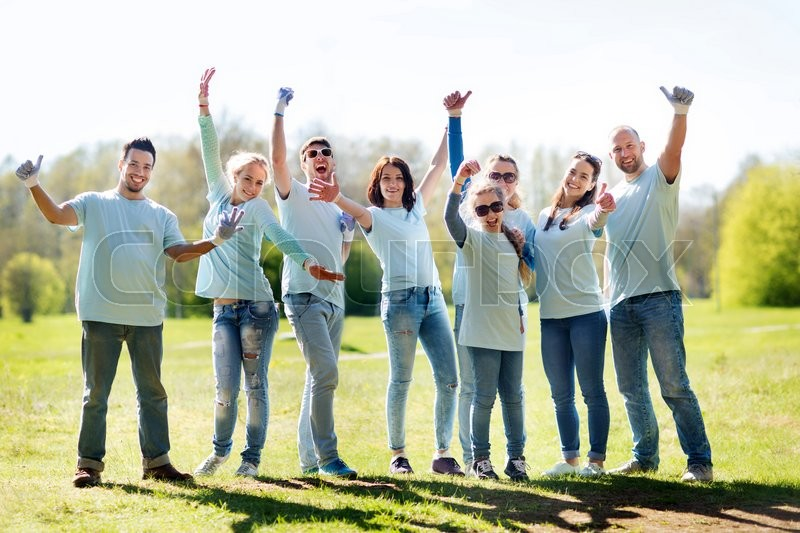 Volunteering, charity, people, gesture and ecology concept - group of happy volunteers showing thumbs up in park, stock photo