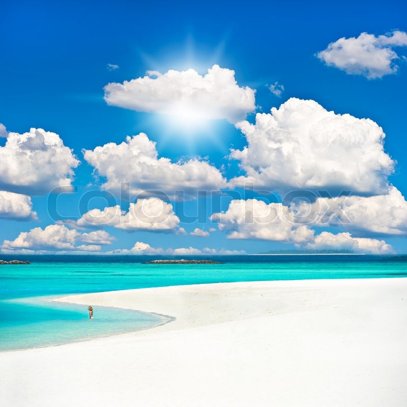 Sand Beach In Summer Sky Background: Tropical Sand Beach Over Cloudy Sky. Holiday Background