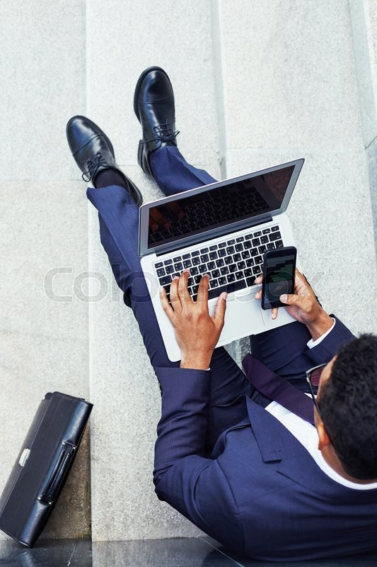 Stock Bild von 'telefon, person, laptop'