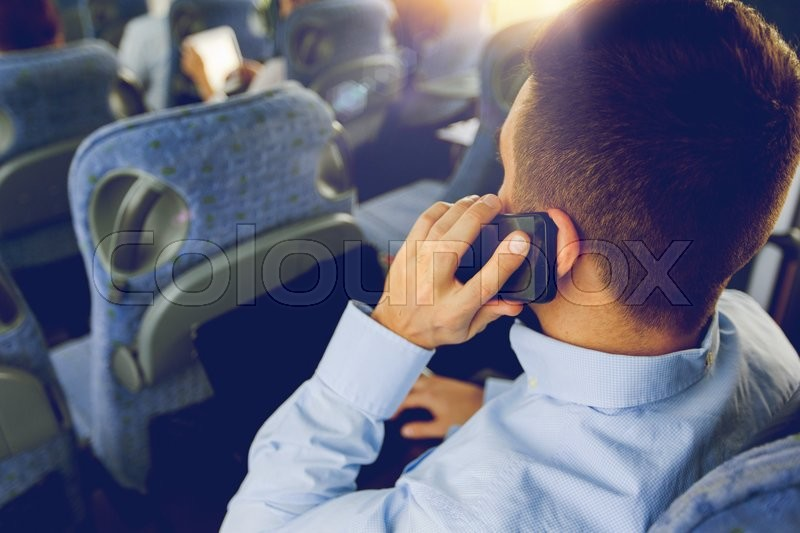 Transport, tourism, business trip and people concept - close up of man with smartphone and laptop calling in travel bus, stock photo