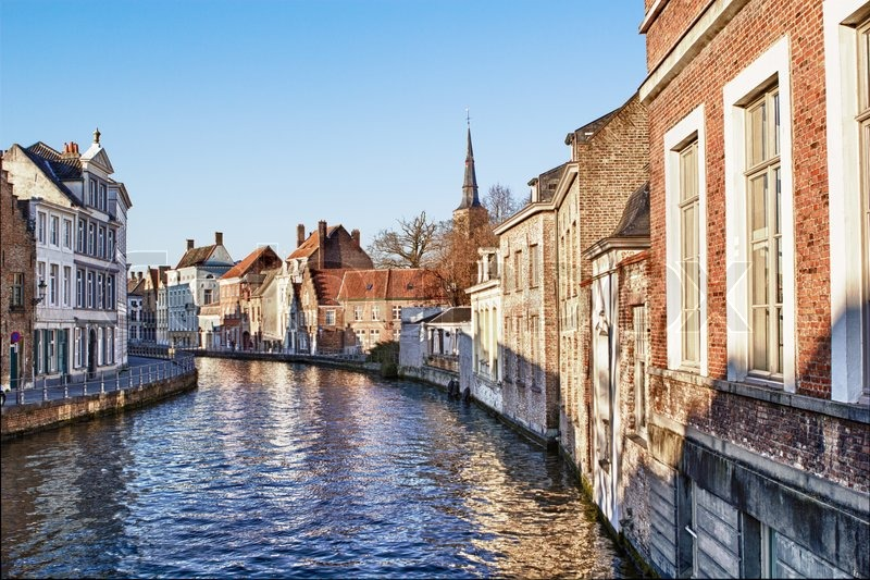 Pretty Canal Scene With Beautiful Architecture In Bruges