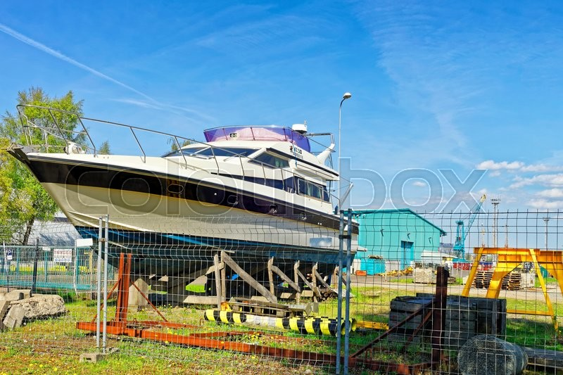 Stock image of 'Yacht in the street in Ventspils of Latvia. Ventspils is a city in the Courland region of Latvia. Latvia is one of the Baltic countries.'