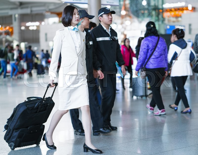 Editorial image of 'Incheon, South Korea - February 15, 2016: Asian Korean female air flight attendant in International airport of Incheon. It is one of the largest and busiest world airports.'