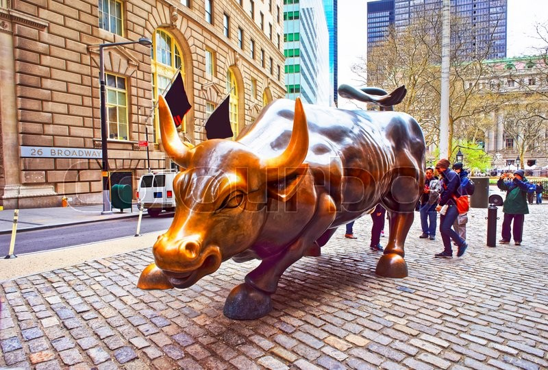 Editorial image of 'New York, USA - April 24, 2015: Charging Bull at Wall Street in Financial District in Lower Manhattan, New York City, USA. Tourists in the street'