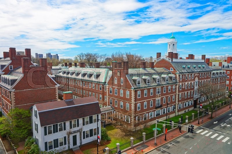 Stock image of 'Aerial view on John F Kennedy Street in Harvard University Area in Cambridge, Massachusetts, the USA. Eliot House white belltower seen on the background. Tourists in the street'