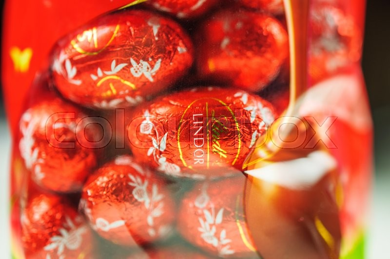Editorial image of 'KILCHBERG, SWITZERLAND - MARCH 20, 2014: Lindt Lindor chocolate truffle easter egg chocolate. Lindt is one one of the lastgest luxury chocolate and confectionery company worldwide with more than 30 factories worldwide'