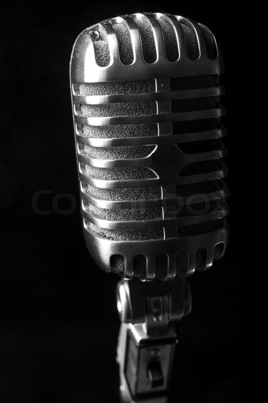 Stock image of 'Vintage microphone on black background'