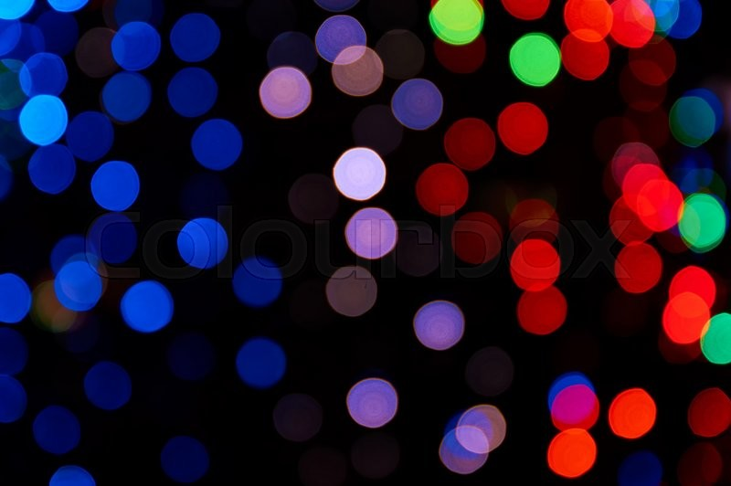 Stock image of 'Colorful bright bokeh on a black background'