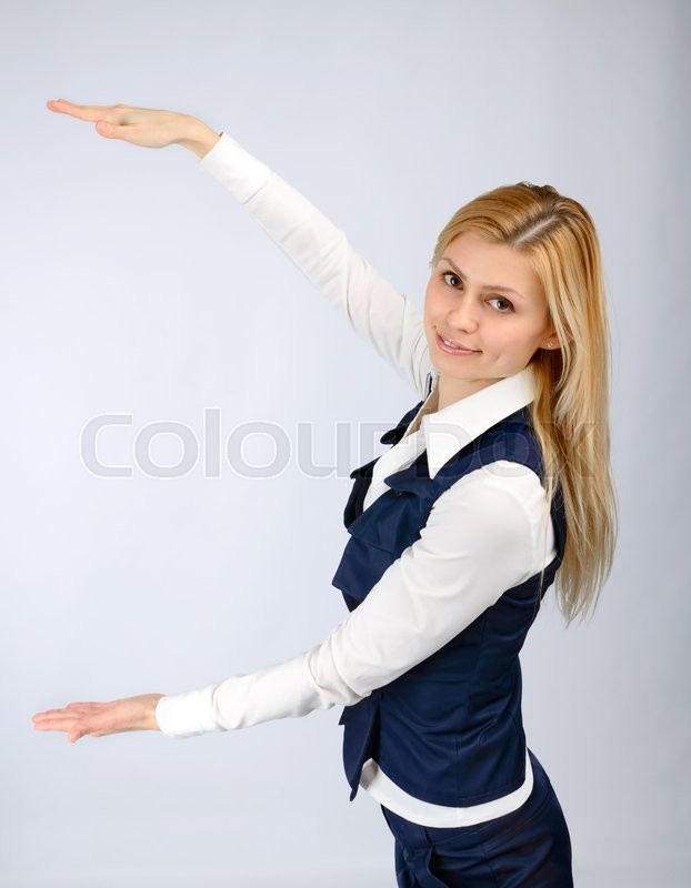 Stock image of 'Presentation concept. Business woman in a suit shows a hands'