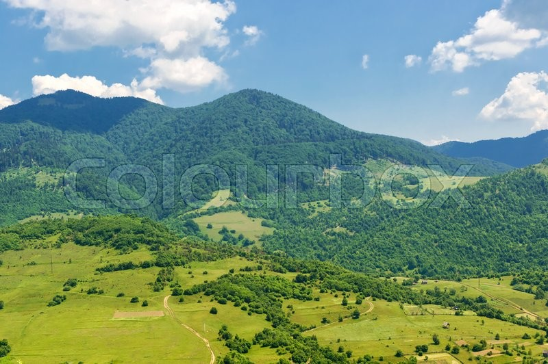 Stock image of 'Mountain valley on a background of cloudy sky. Summer landscape'