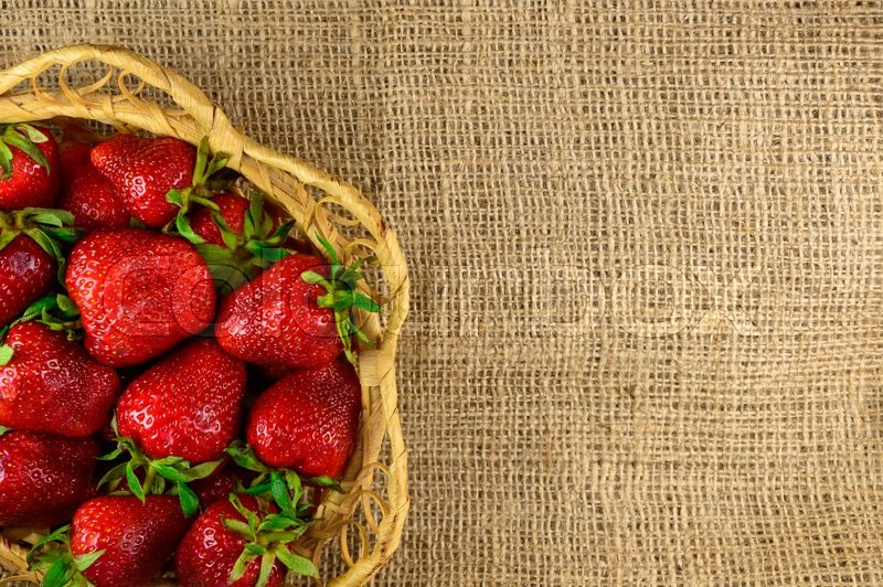 Stock image of 'Juicy strawberries in a basket. design element'