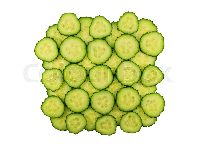 Stock image of 'Sliced cucumber discs isolated on white background'