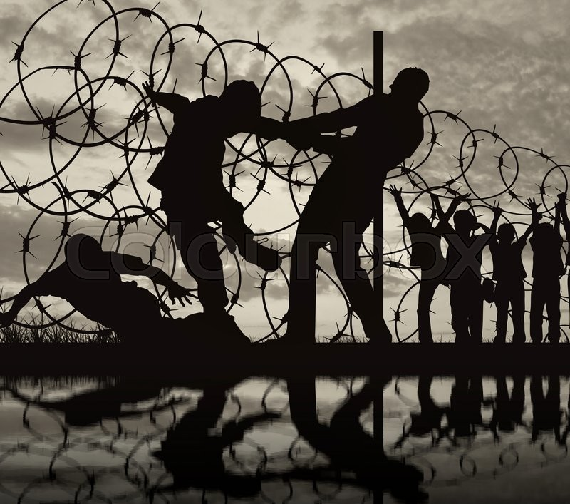Stock image of ' Concept of security. Silhouette of refugees climb over the barbed wire at the border and reflection'