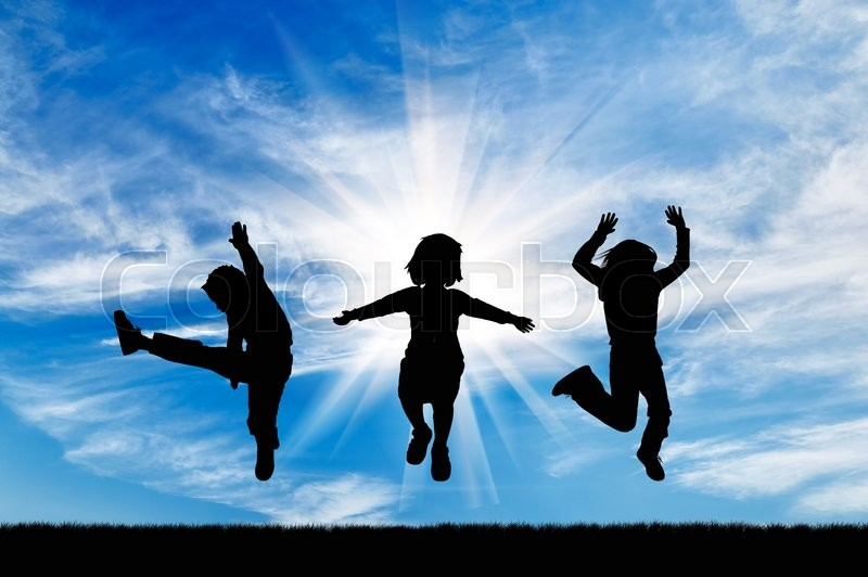 Stock image of 'Concept of happiness. Silhouette happy children jumping against the beautiful sky'