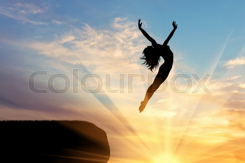 Stock image of 'Concept of happiness and freedom. Silhouette of happy woman jumping at sunset'