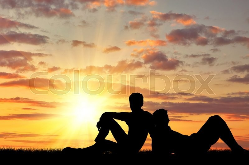 Stock image of 'Concept of gay people. Silhouette of two gay vacationers at sunset'