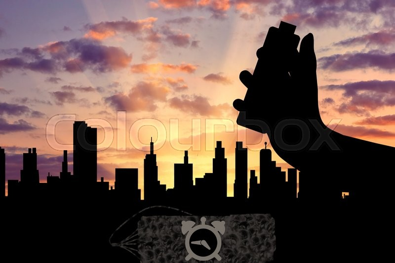 Stock image of 'Concept of terrorism. Silhouette of a bomb with a detonator in his hand against the evening city'