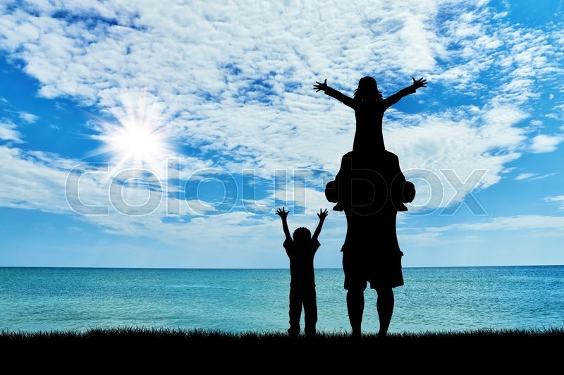 Stock image of 'Concept travel. Silhouette of a family against the backdrop of the sea and the beautiful sky'