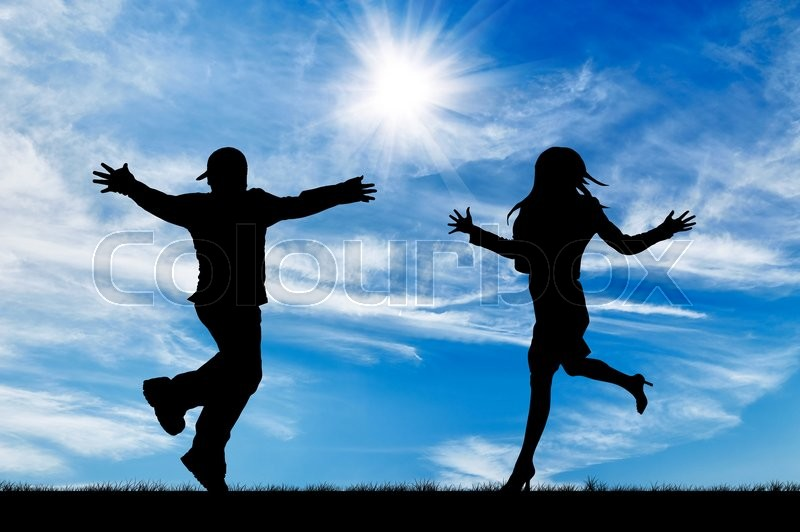Stock image of 'Concept of emotion. Silhouette of running to meet the man and woman on the background of the sunny sky'