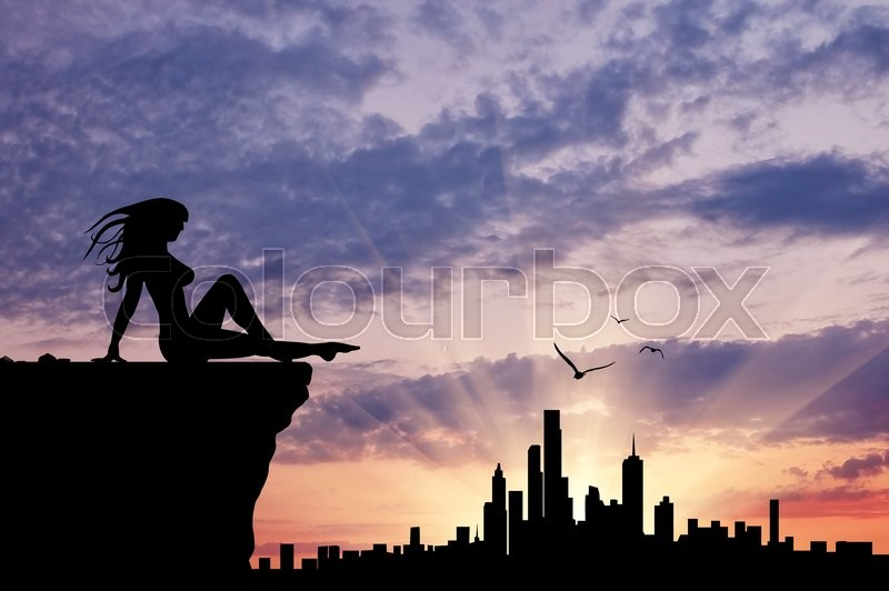 Stock image of 'Silhouette of a girl sitting gazing at the city sunset'