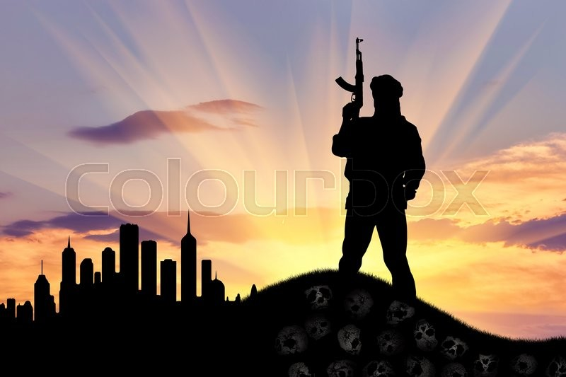 Stock image of 'Concept of terrorism. Silhouette of a terrorist with a rifle standing on a pile of skulls on the background of evening city'