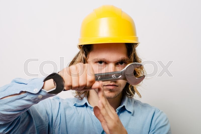 Stock image of 'A man shows the hands stop timeout. On a gray background.'