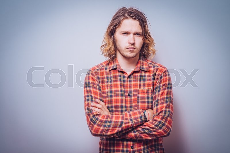Stock image of 'Portrait of a man arms folded'