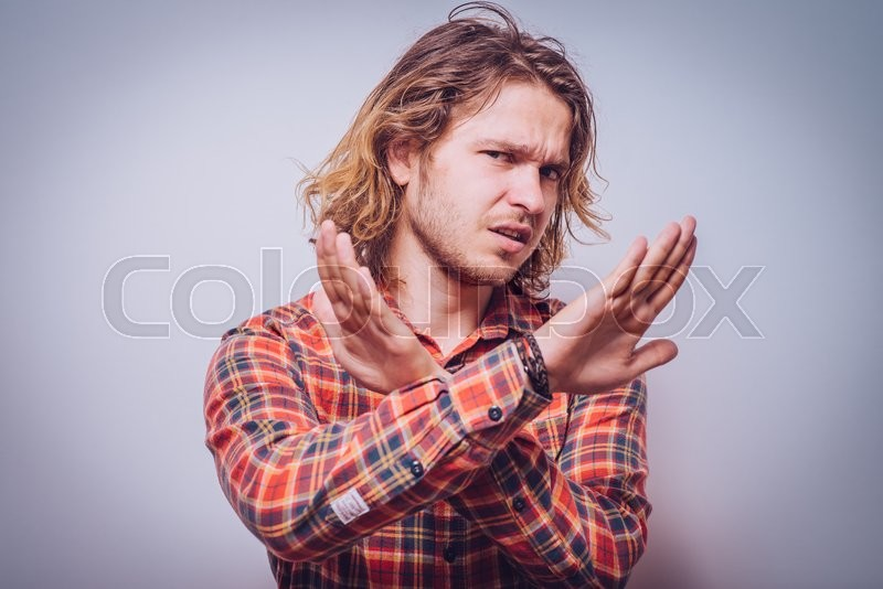 Stock image of 'Stop gesture with indignation shown by men'