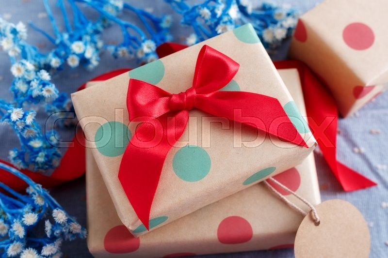 Stock image of 'Gift box with red bow for holiday'