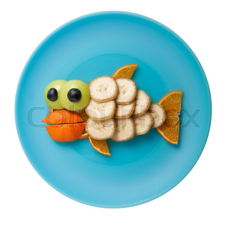 Stock image of 'Fish made of fruits on blue plate'
