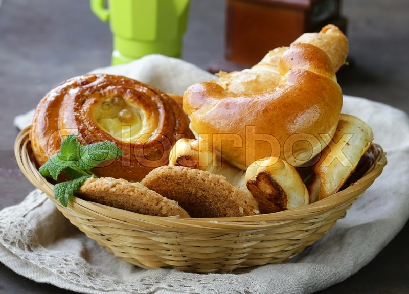 Stock image of 'Homemade baked buns  brioche, crescent rolls, croissants and biscuits'
