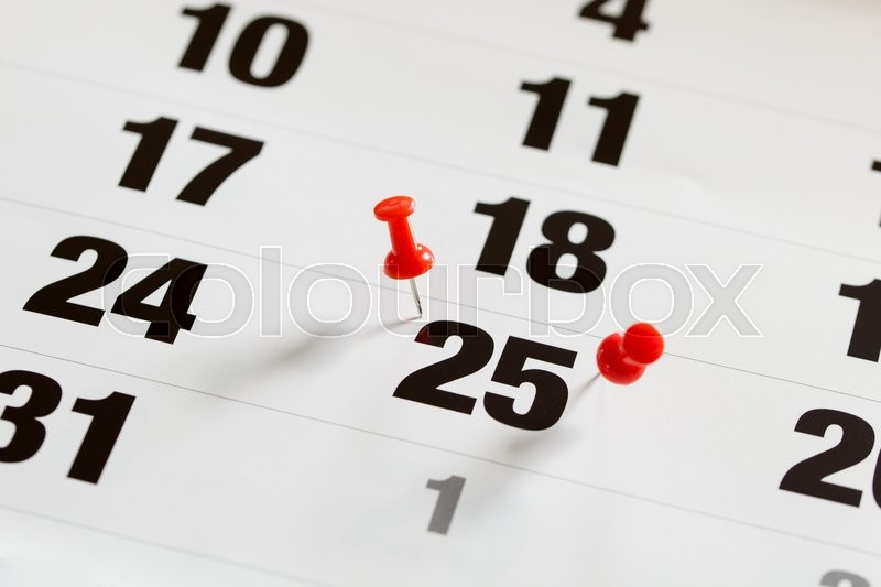 Stock image of 'Pin pushed on a calendar concept for an important day.'