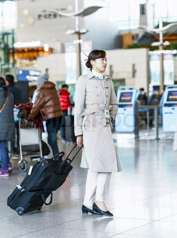 Editorial image of 'Incheon, South Korea - February 15, 2016: Asian Korean air flight stewardess at the Incheon International airport. It is one of the largest and busiest world airports.'