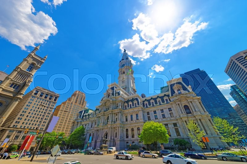 Editorial image of 'Philadelphia City Hall with William Penn figure on Tower. View from the street. Tourists in the street. Pennsylvania, USA'