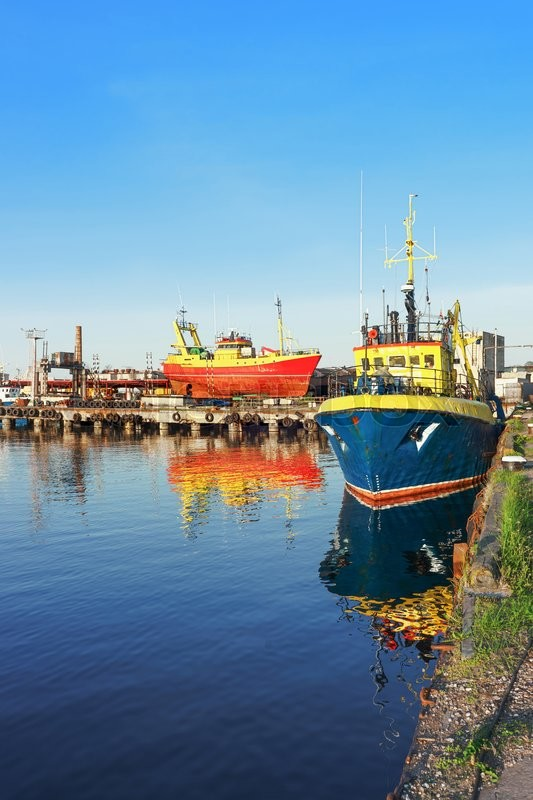 Stock image of 'Two Ships on the Marina in Ventspils in Latvia. Ventspils a city in the Courland region of Latvia. Latvia is one of the Baltic countries'