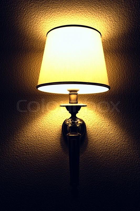 Interior with lighting lantern on wall in the dark, stock photo