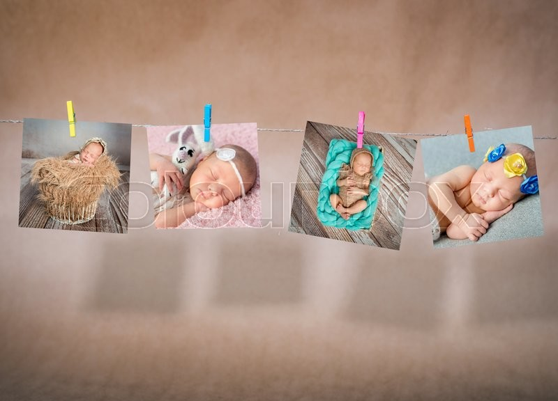 Stock image of 'cards of newborn sleeping babies hanging on the rope on kraft paper background'
